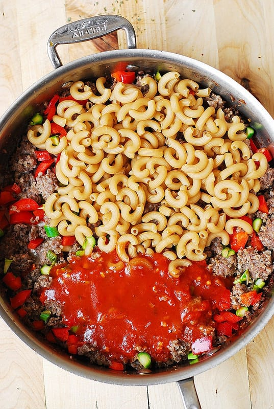 add macaroni to sausage, bell peppers and tomato sauce