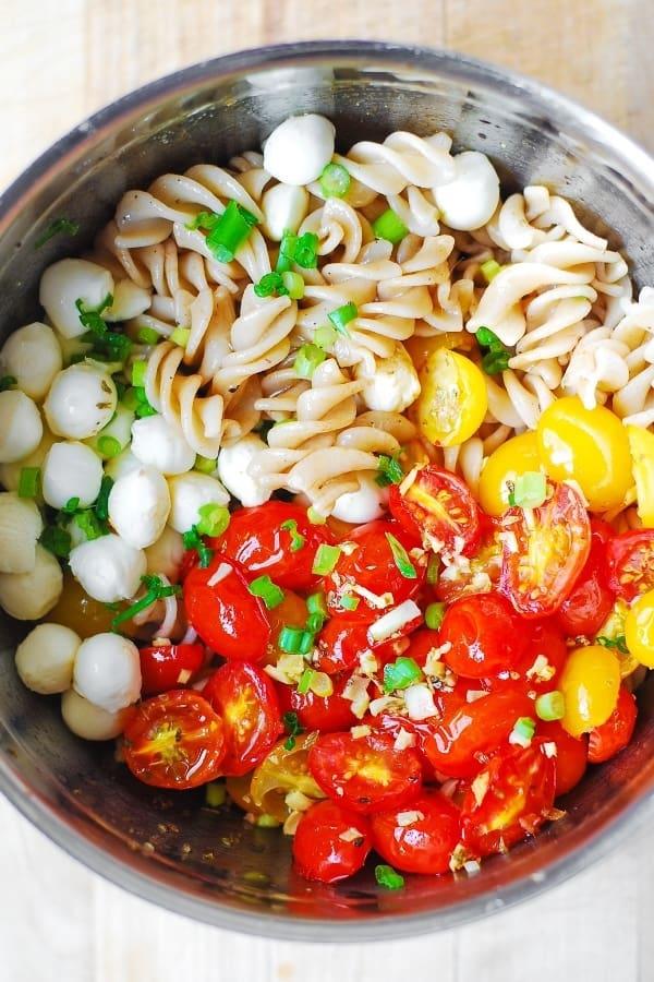 Pasta salad with roasted grape tomatoes, mozzarella cheese, oregano, garlic, fresh basil and homemade olive oil and white wine vinegar dressing