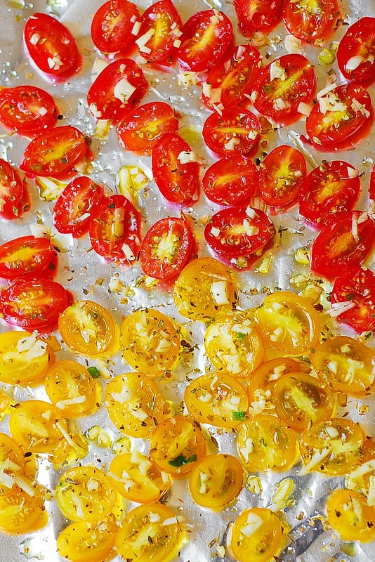roasting tomatoes with garlic and herbs (process shot)