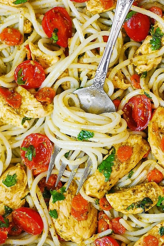 Italian spaghetti, basil pesto and tomatoes, basil pesto pasta