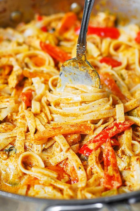 Southwestern chicken pasta with bell peppers in Cheddar and Mozzarella cream sauce