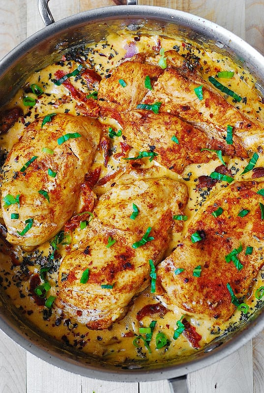 Skinless, boneless Chicken Breast with Creamy Sun-Dried Tomato Sauce in a large all-clad skillet