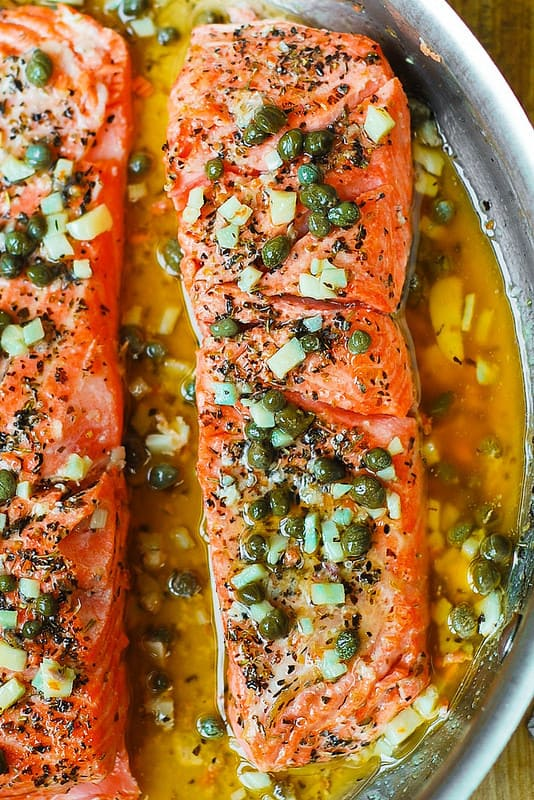 Steelhead Trout with Garlic Butter Lemon Caper Sauce in a skillet on stove top