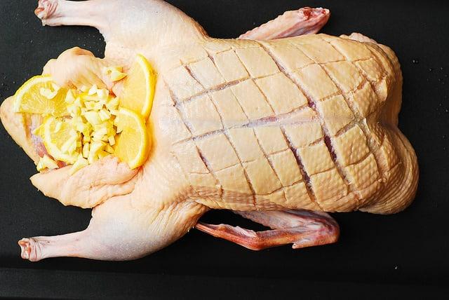add lemons and garlic, roast duck recipe
