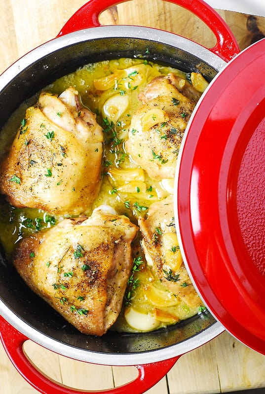 Garlic Thyme Bone-In Skin-On Chicken Thighs in red pan
