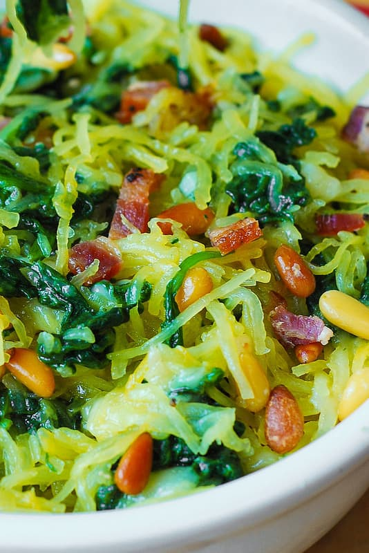 Spaghetti squash with nuts and vegetables in a skillet