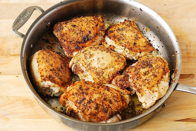 browning chicken skin on chicken thighs in a skillet, baked chicken, how to bake chicken
