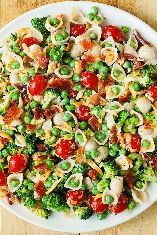 Broccoli Bacon Ranch Pasta Salad with cherry tomatoes, sweet peas