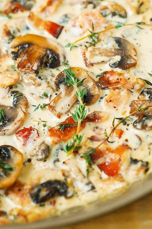 Creamy mushroom thyme sauce with bacon in a skillet