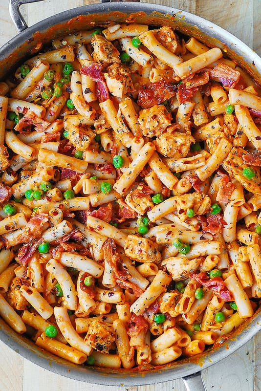 Spicy Chicken Pasta with Bacon and Peas made in a large all-clad skillet