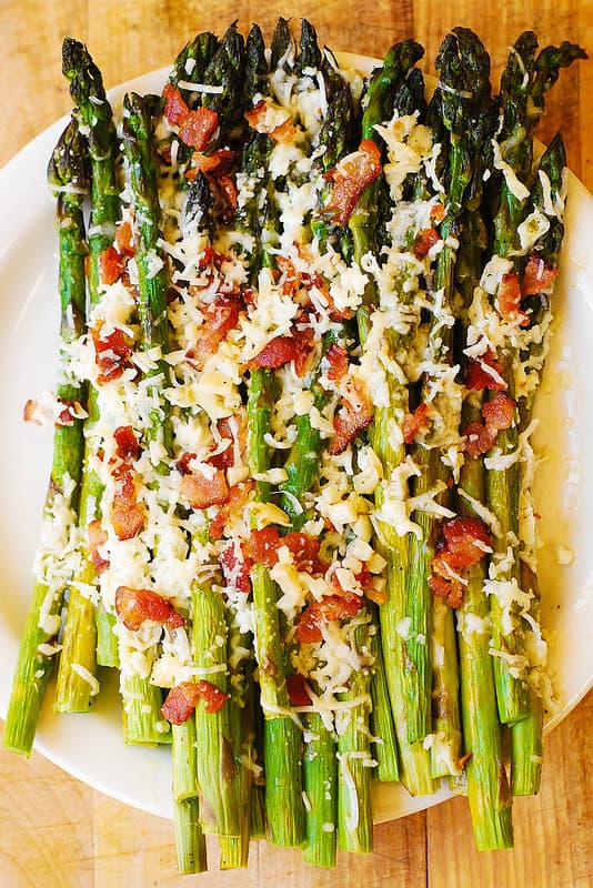 roasted asparagus on a white serving plate