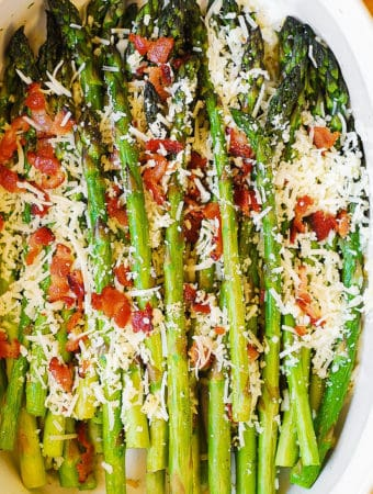 Asiago Cheese and Bacon Asparagus in a white casserole dish