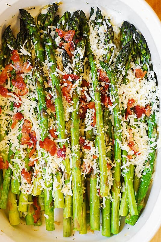 asparagus with garlic, bacon, and Asiago cheese in the casserole dish