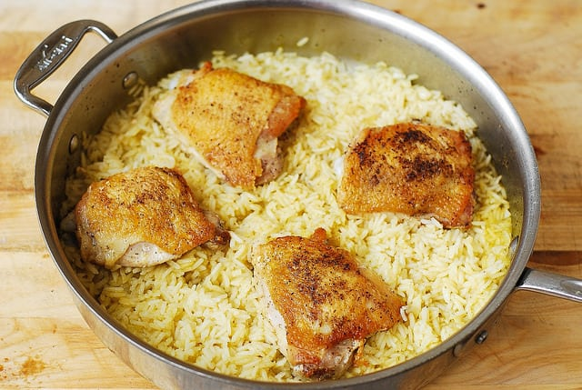 cook chicken and rice for about 20 minutes until chicken is cooked through and rice is done, cilantro lime rice, healthy rice recipes, healthy chicken recipes, how to cook chicken thighs, stove top chicken thighs