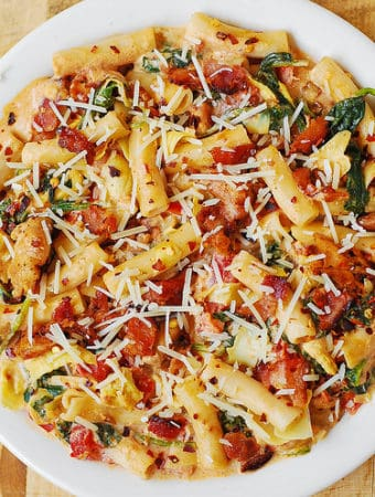 Spinach and Artichoke Chicken Pasta with Bacon and Tomatoes