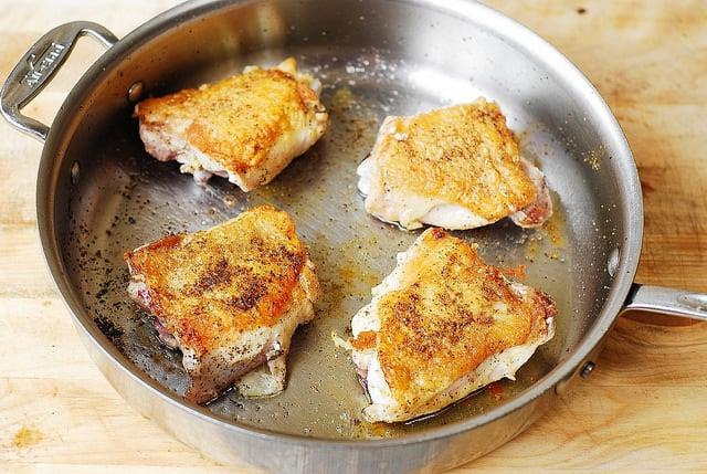 cook chicken thighs until skins are golden brown