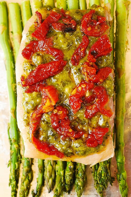 Basil Pesto Sea Bass and Veggies (Asparagus and Sun-Dried Tomatoes) baked in foil