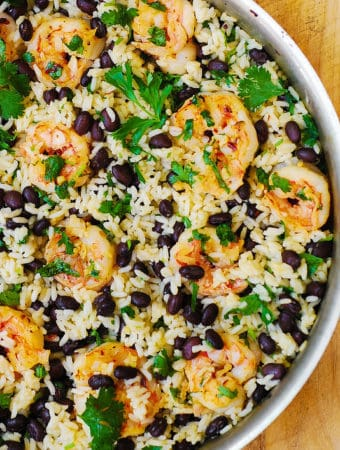 Black bean and cilantro-lime shrimp with rice in a stainless steel skillet