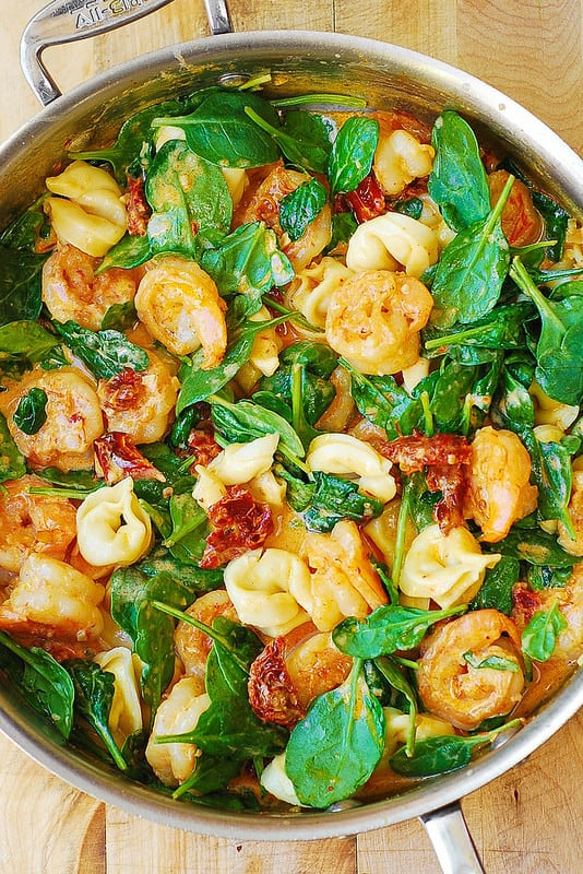 spicy shrimp smothered in a creamy Mozzarella cheese sauce with sun-dried tomatoes and spinach