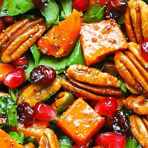 butternut squash and spinach salad with cranberries, pecans, pomegranate seeds