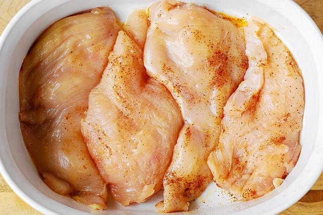 seasoned chicken breasts, chicken breasts recipes, chicken breasts in a casserole dish
