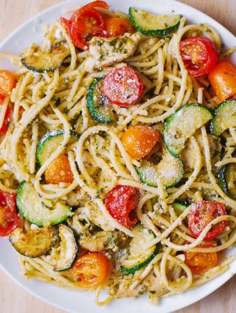 Chicken Spaghetti with Cherry Tomatoes, Zucchini, and Basil Pesto on a white plate
