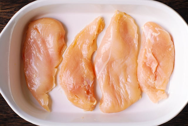 place chicken breasts in a white casserole dish