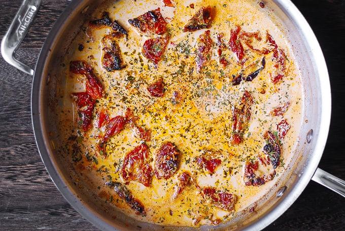 creamy mozzarella cheese sauce in a large skillet