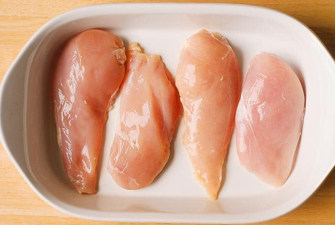add boneless, skinless chicken breasts into the baking dish