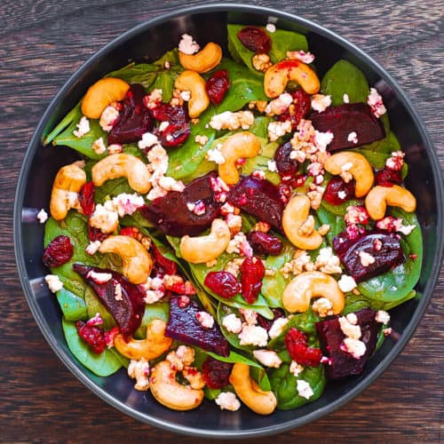 Beet Salad with Spinach, Cashews, Cranberries, and Goat Cheese with honey, lemon and olive oil dressing