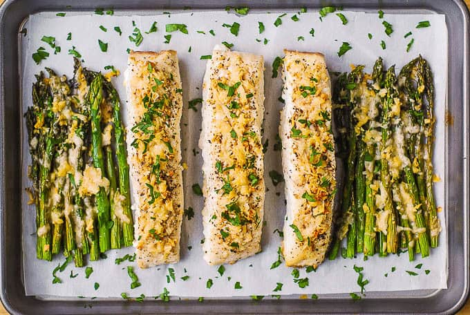 halibut and asparagus on baking sheet