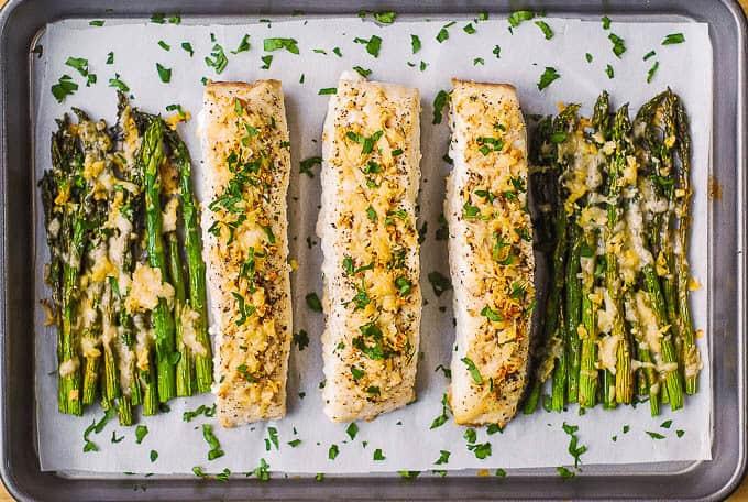 halibut and asparagus on baking sheet