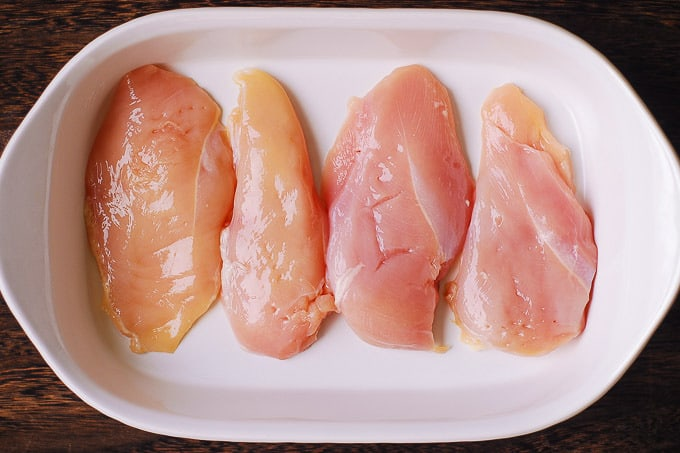 add raw chicken to the casserole dish