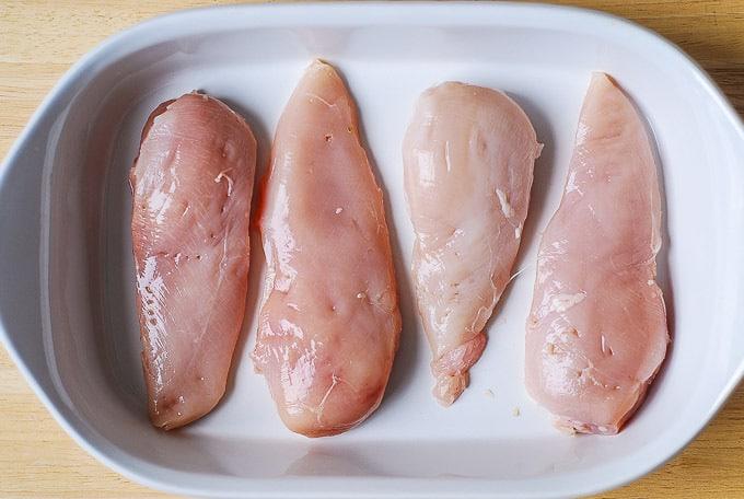 add chicken breasts to a casserole dish