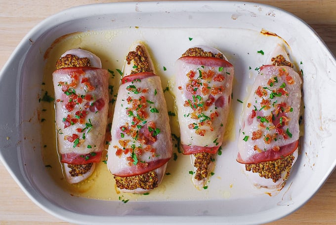 Top chicken with crumbled bacon and chopped herbs