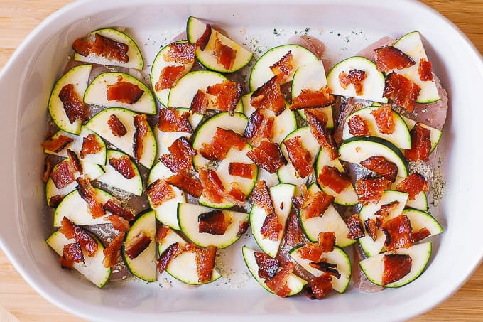 chicken breasts with sliced zucchini and chopped bacon