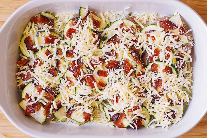 chicken breasts with sliced zucchini, chopped bacon, Parmesan, Mozzarella cheese