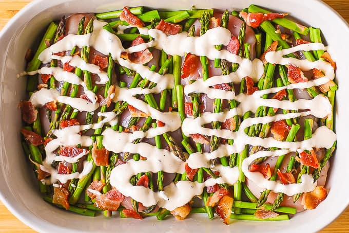 chicken breasts, asparagus, bacon, Ranch dressing in a casserole dish