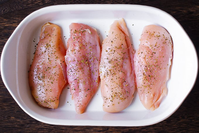chicken breasts in a casserole dish