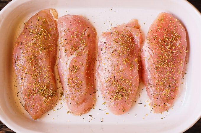 seasoned chicken breasts in a casserole dish