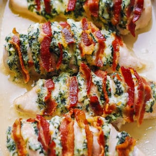 hasselback chicken with cream cheese, mozzarella, parmesan, spinach, and bacon