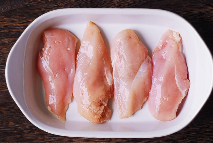 add chicken breasts in a casserole dish