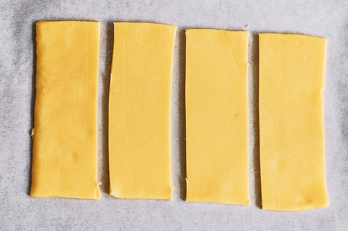 puff pastry sheet cut in 4 rectangles on baking sheet