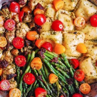 chicken ravioli with pesto, asparagus, tomatoes