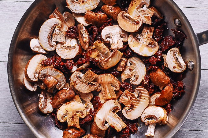 mushrooms and sun-dried tomatoes in a skillet