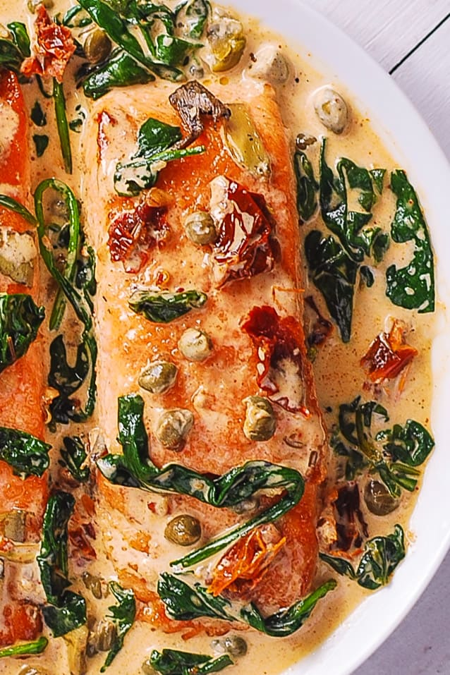 Creamy Tuscan Salmon with Spinach, Artichokes, Garlic, and Capers