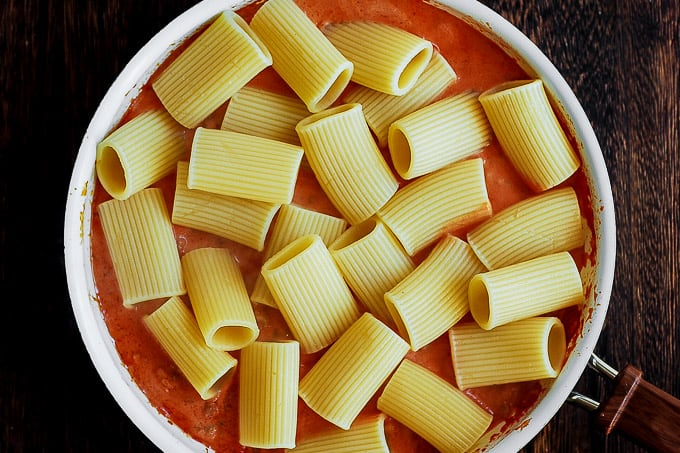 paccheri pasta with tomato sauce in a skillet