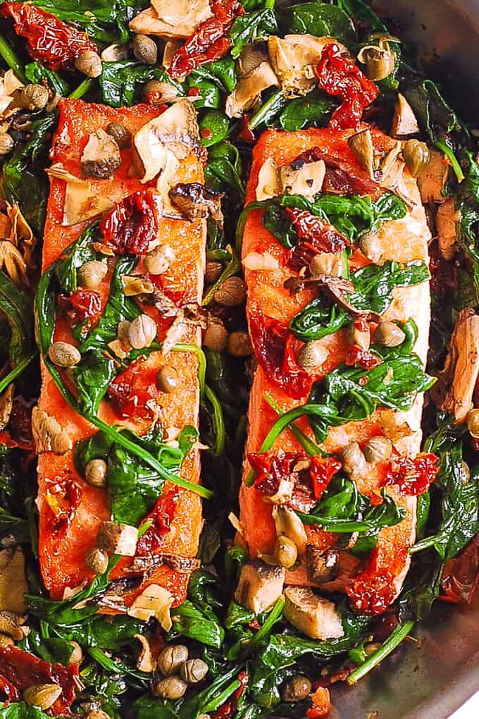 Pan-Seared Salmon with Spinach, Garlic, Sun-Dried Tomatoes, Artichokes, Capers
