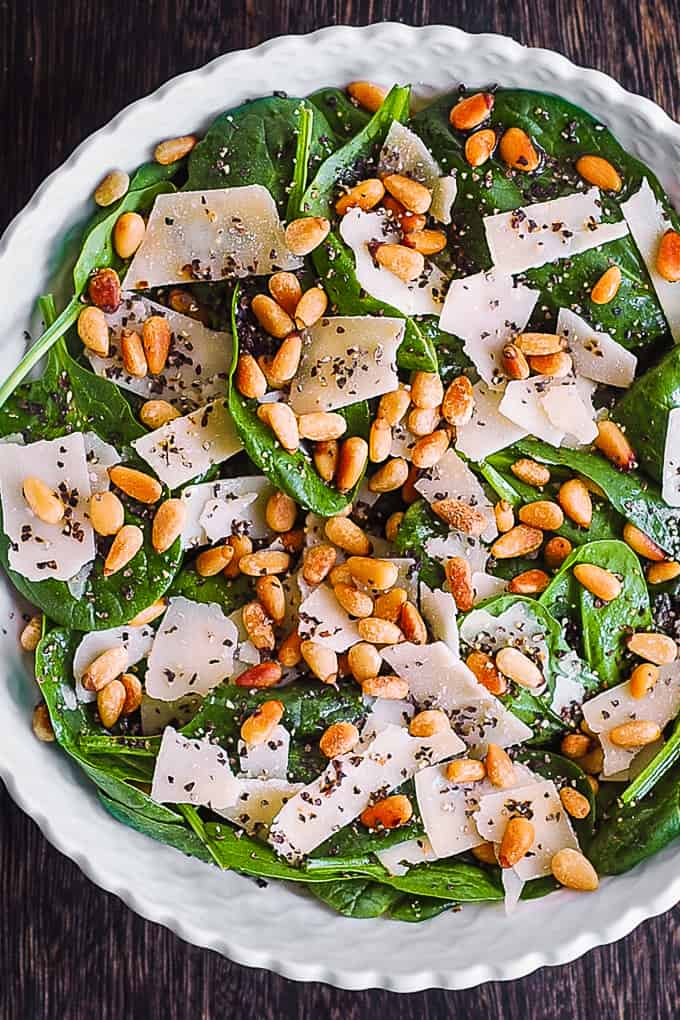 simple spinach salad with pine nuts and parmesan cheese