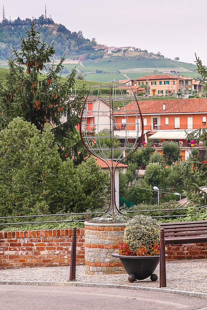 oversized wine glass with buildings in the background in Barolo, Piedmont